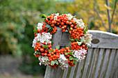 Wreath of rowan berries, hydrangea flowers and rose hips