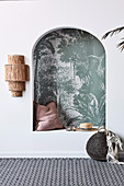 Sitting alcove with arch and green jungle motif wallpaper