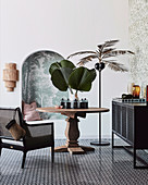 Urban jungle style seating area with wooden table and palm tree floor lamp next to alcove