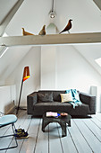 Modern, modern couch in attic room of renovated Dutch townhouse