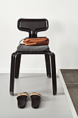 Bathroom utensils on black designer chair