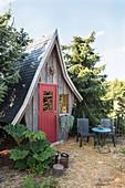 Fairy-tale wooden cabin in garden