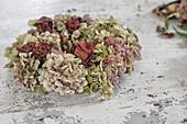 Handmade hydrangea wreath on white shabby-chic table