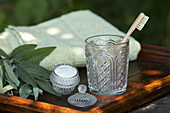 Homemade spearmint toothpaste, glass and toothbrush
