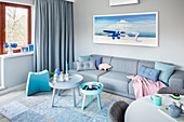 Modern living room in blue, grey and pink