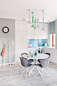 Modern kitchen-dining room with dining set and pastel accents