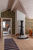 Antique wood-burning stove and William Morris wallpaper in airy living room