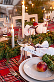 Festively set dining table decorated with kale