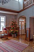 Christmas tree in foyer of Scandinavian villa