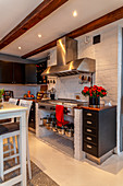 Gas cooker in modern black-and-white country-house kitchen