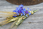 A bouquet of cornflowers, ears of rye and barley