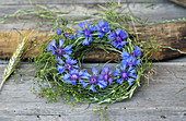 Wreath of grasses and bedstraw with cornflowers