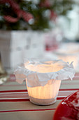 Handmade candle lantern with white tissue-paper cover