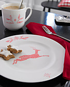 Crockery painted with red cross-stitch pattern