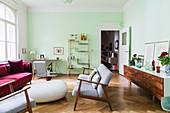Sofas and armchairs, rosewood sideboard and brass shelves in living room