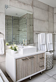 Square sink on base unit in modern bathroom in shades of grey