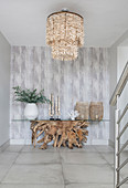 Console table made from burl wood and glass in exotic foyer