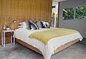 Cushions and pictures with jungle motifs in bedroom
