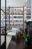 Library room with floor-to-ceiling bookshelves and shelf ladder