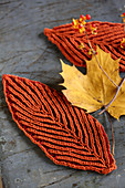 Rusty-red leaf-shaped coasters for decorating autumnal table