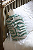 Hand-knitted mint-green cover for hot water bottle