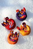 Colourful, handmade, bird-shaped, felt Christmas tree decorations