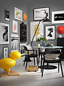 Gallery of pictures in monochrome dining room