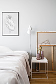 Canvases behind bedside table in ecru bedroom