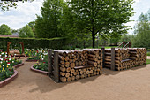 Firewood stacked to form seats with added seat boards