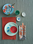 Oriental-style place setting with printed crockery