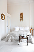 Light-flooded bedroom with stucco ceiling