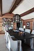 Rustic dining room with open fireplace and exposed ceiling beams
