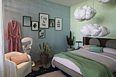 Walls of different colours and cloud-shaped pillows hung from ceiling in bedroom