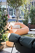 Various seating and potted plants in outdoor area