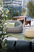 Various seating and potted plants in outdoor lounge area