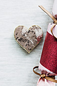 Sequin brooch in heart shape and packaging in candy shape