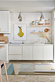 White kitchen with light wood accents and white subway tiles