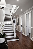 Classic hallway with stairs and panelled walls