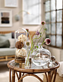 Unusual flowers in glass vases on rattan table
