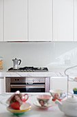 Espresso pot on gas cooker in white, modern kitchen