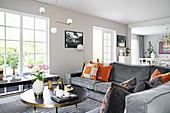 Grey velvet sofa in elegant open-plan interior