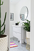 View into bathroom with classic washstand and houseplants