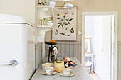 Retro fridge in bright kitchen in vintage country-house style