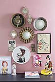 Votive items decorating pink walls