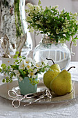 Posy of summer jasmine, pears and pastry tongues on silver platter