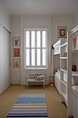 White bunk beds in children's bedroom