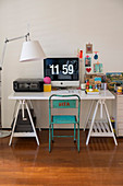 White trestle desk, vintage chair and standard lamp