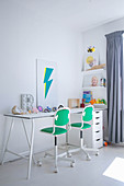 White desk and green-and-white office chairs