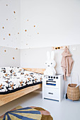 Two-tone walls decorated with stars in child's bedroom