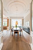 Open-plan interior with stucco and pillars in Wilhelmine-era villa